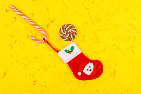 Christmas and New Years concept. Christmas Sock and lollipops, candy kane. Top view, copy space