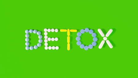 Detox - medical concept. Pharmacology and pharmaceuticals. Pills of various shapes and colors are laid out in the form of the word DETOX