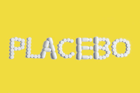 Placebo is a medical concept in trendy colors. The tablets are lined with the word PLACEBO.Ultimate Gray and Illuminating