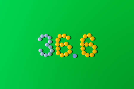 Pills of different colors are laid out in the form of the number 36.6