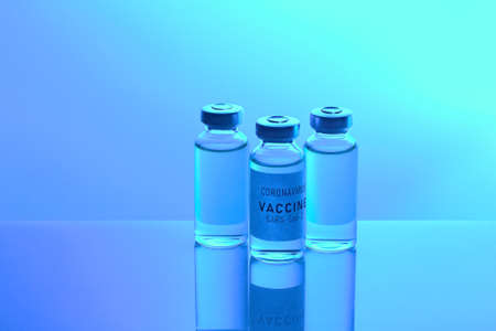 Vaccine values during the acute period of the  pandemic concept. Vials on a blue background