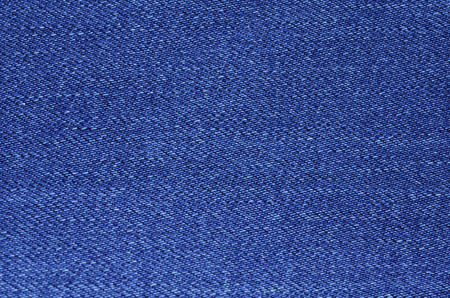 blue texture maden from a piece of jeans blurred toned Stok Fotoğraf - 106685851
