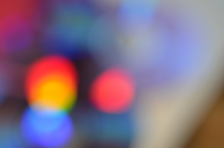 Natural abstract colorful bokeh background received from the light of lamp on CD disk with glitter, defocused