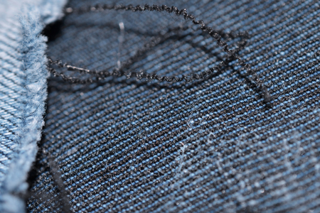 blue texture maden from a piece of jeans with torned hole with threads blurred toned Stok Fotoğraf - 106686522