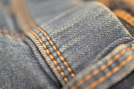 blue texture maden from a piece of jeans blurred toned Stok Fotoğraf - 106686762