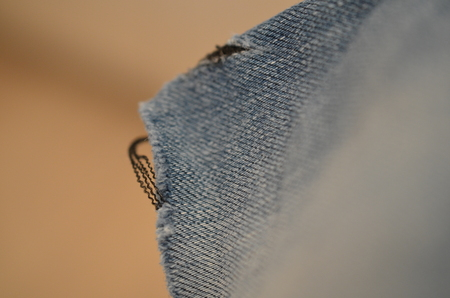 blue texture maden from a piece of jeans blurred toned Stok Fotoğraf - 106686764