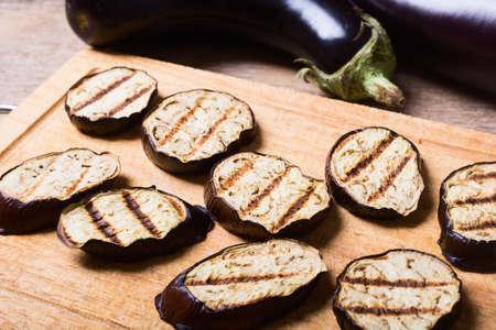 seasoned: grilled eggplants seasoned on a wooden background