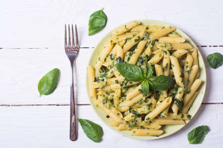 pasta with spinach pesto sauce, green basil