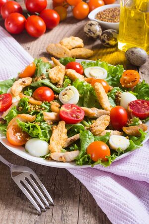 chicken caesar salad: Healthy Chicken Caesar Salad with tomato and Croutons