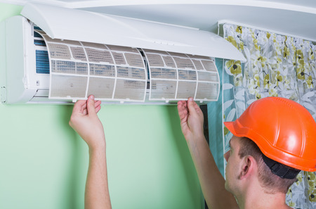 Repairman change air conditioner filter for clean