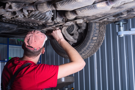 auto repair: Mechanic repair car on auto service