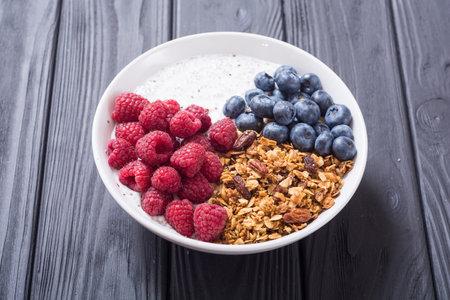 Chia yogurt with granola and berries  ( blueberries , raspberry )