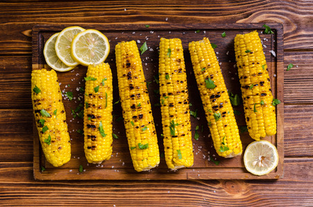 Barbecue of grilled corn with parsley and salt Stock Photo