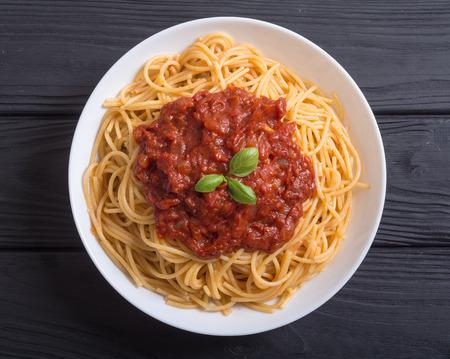 Italian pasta spaghetti with tomato sauce and basil