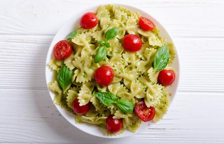 Pasta with sauce pesto . Italian food background