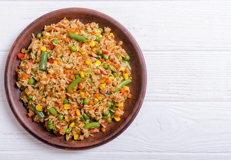 Food background . Risotto with vegetables on rustic background