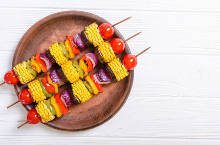 Barbecue with vegetable skewers . Healthy food background
