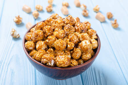 Sweet caramel popcorn . Food and snack background in bowl