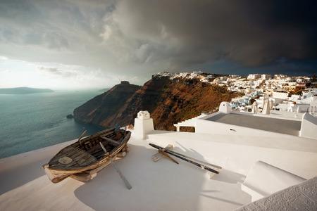 firostefani: Old Boat on Roof Before Thunderstorm, Santorini