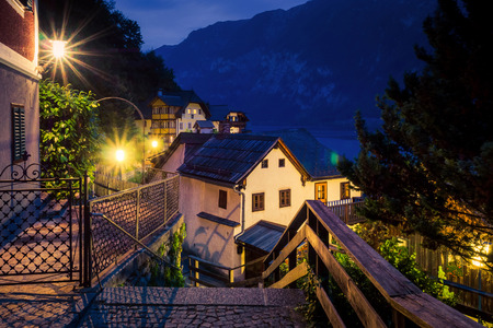 Night view of the street and authentic houses in Hallstatt, Austria.