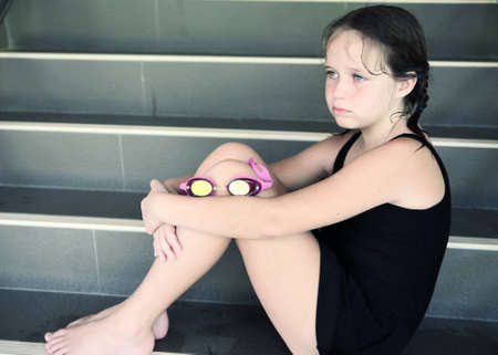 Upset girl after the pool with pink glasses photo