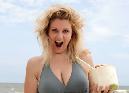 surprised woman on the beach photo