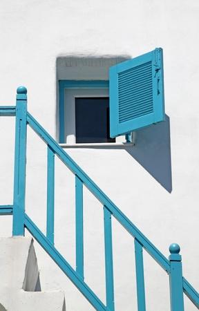 parapet wall: open blue window leaf in Greek style