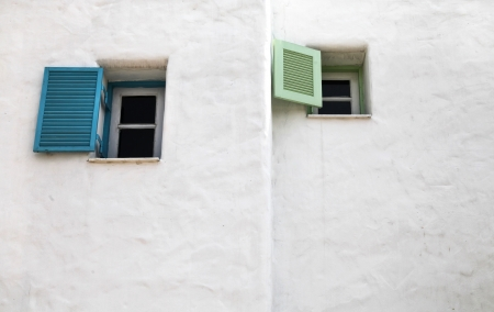 Two open greek windows on the old wall photo