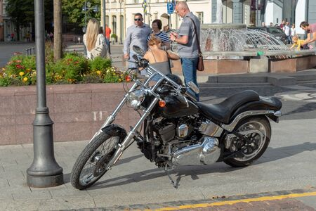 LITHUANIA, VILNIUS - AUGUST 15, 2019:  The biker season is in full swing. A powerful motorcycle is parked in the central square of the city. A familiar sight for people in Vilnius.