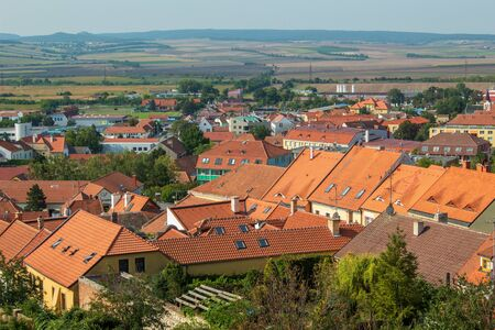 View of the city from the park of Mikulov Castle. Traditional Czech red roofs of houses. Mikulov, Czech Republic. Stok Fotoğraf