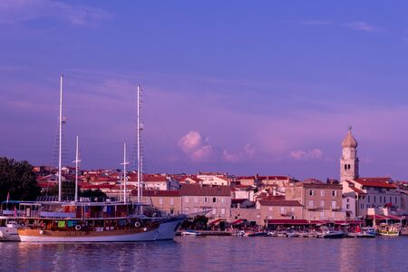 Evening view of the pier of the old city. Krk, island of Krk, Croatia. Stok Fotoğraf