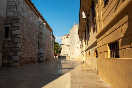 The street leading to the square near the ancient defensive wall. Krk, island of Krk, Croatia.