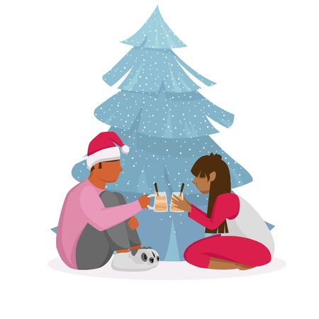 people celebrate Christmas. a young couple at a Christmas tree. the guy with the girl cocktails
