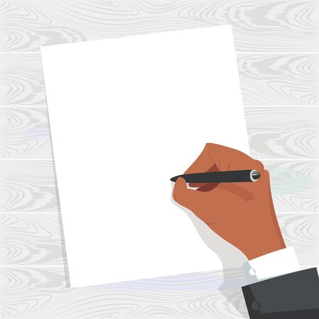 the hand writes. blank form. a person writes a letter. hand on the table. wooden background