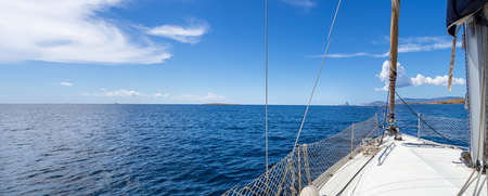 Panoramic of the larboard of a sailboat in the Mediterranean sea. Vacation, summer and adventure concept. Calm ocean while sailing. Stock Photo