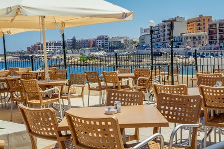paradise bay: Cafe on the beach in Bugibba, Malta Stock Photo