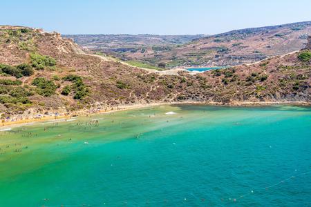 blue lagoon: Tuffieha Bay Beach in Malta Stock Photo