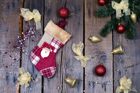 christmas sock: Christmas sock and Christmas decorations on wooden background