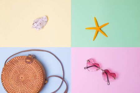 starfish, shell, heart-shaped sunglasses and a woven bag on a colorful background in pastel colors