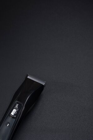 hair clipper on a black background with copy space