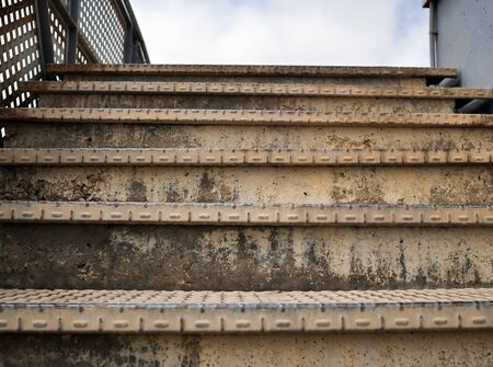 Old rusty metal staircase, close-up