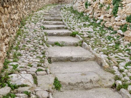 Old stone steps, stairs in an old abandoned fortress