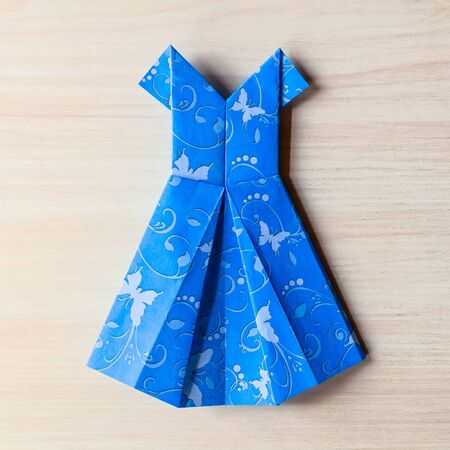 Origami made blue dress from butterfly printed paper.