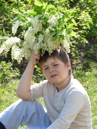 A boy with a bouquet of lilacs Stock Photo - 7868321