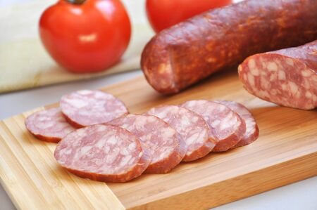 mouthwatering: Mouth-watering smoked sausage and ripe tomatoes