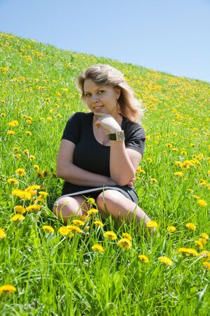 Portrait of a young girl on the lawn photo