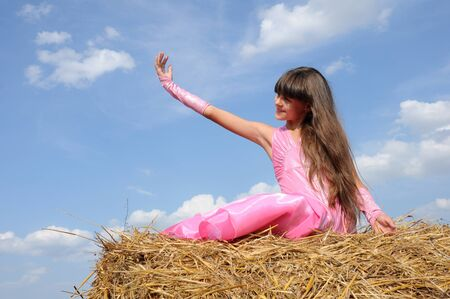 A girl in a field stretching to the sky Stock Photo - 10195944