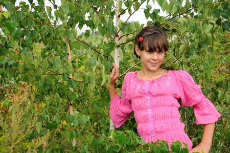 Russian girl stands near the birch Stock Photo - 10224056