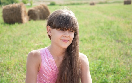 brown haired girl: Portrait of a beautiful dark-haired girl in a field