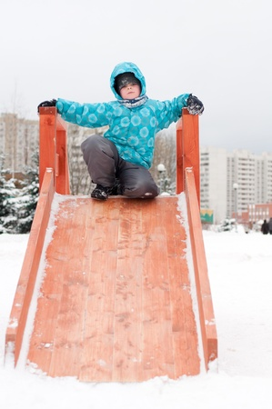 7 8 years: The boy is riding a wooden hills in the winter